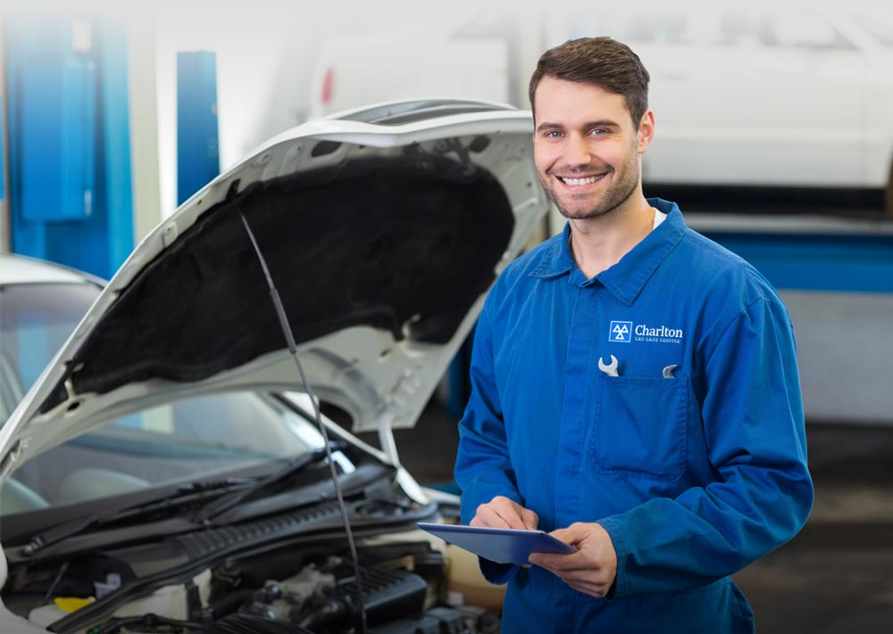 Charlton Car Care Services Mechanic smiling in a blue overall