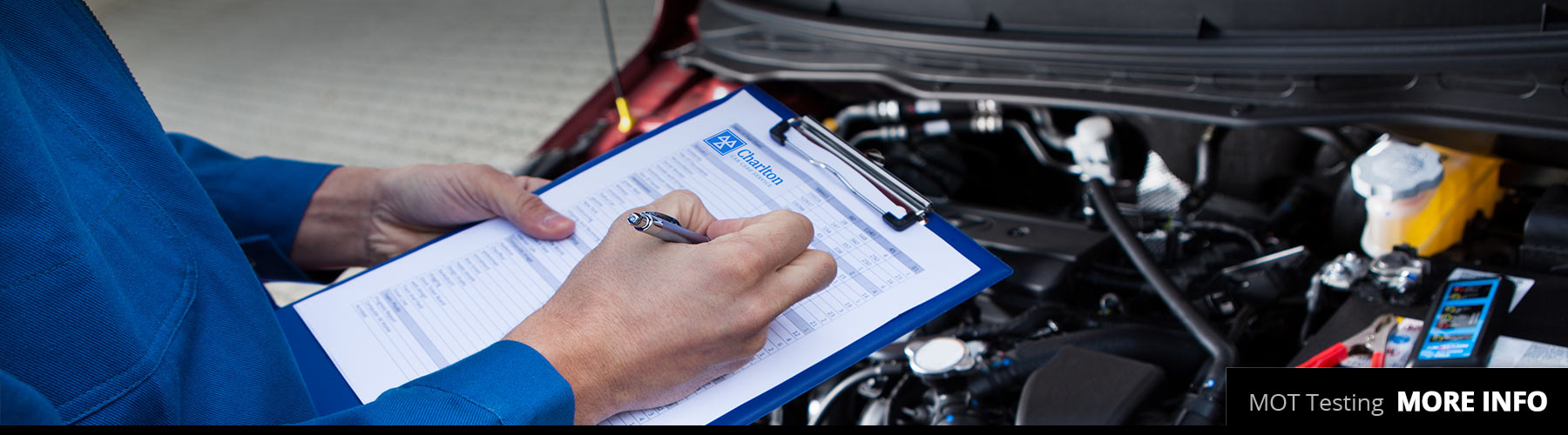Man with clipboard checking off items to pass MOT Test